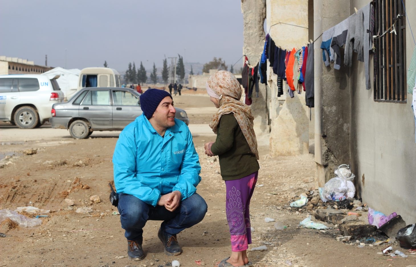 "January 2017, Boushra, 9, displaced from east Aleppo We met 9 year-old Boushra while she was waiting next to a clothesline near her new home, a former warehouse now housing over 5,000 people displaced from eastern Aleppo. ""I am waiting for my clothes to dry,"" says Boushra, who has been in Jibreen for two months after her home in east Aleppo was completely destroyed. ""When we fled our home, we couldn't bring anything with us."" Boushra's mother explains. ""All my children had one outfit only when we arrived here."" Boushra and her siblings were among 31,000 children who received winter clothes distributed by UNICEF in Aleppo.Some 31,5000 people are reported to have been displaced from and within eastern Aleppo City since 24 November. Temperatures are dropping quickly and heavy rainfall has made conditions even worse over the past few days. UNICEF is providing blankets and winter clothing, as well as access to safe water, essential medical care, including vaccinations and psychosocial support for children who have lived through such horrors.In Jibreen, to the east of Aleppo City, children and their families displaced by recent fighting in eastern Aleppo take shelter in a large warehouse in an area under Government control. Some 8,000 people are sheltering there.In Hanano, in east Aleppo City was the first district to be retaken by Government forces on 27 November. People are now moving back to the area as the frontline of fighting has moved further away. This includes families returning to their homes, as well as displaced families from other areas of east Aleppo."